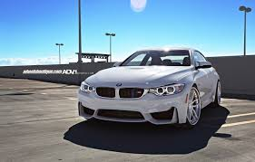 bmw m4 stanced alpine white f82 bmw m4 sits on adv 1 wheels installation by