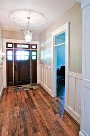 craftsman style flooring neutral craftsman foyer with dark wood door white wainscoting