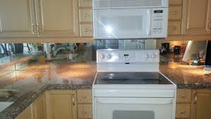 kitchen backsplash mirror yes to mirror backsplash or no