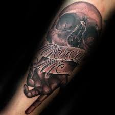 horrible grey ink skull and mercy me banner tattoo design for men