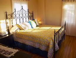 bedroom small bed room with black wrought iron king size bed with
