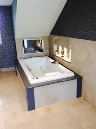 tv in bathroom is a tv in the bathroom a necessity or a luxury the