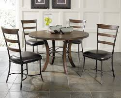 round wood dining table with metal acent base by hillsdale wolf