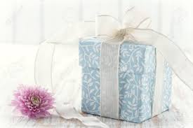 floral gift box light blue floral gift box up with white ribbon and pink