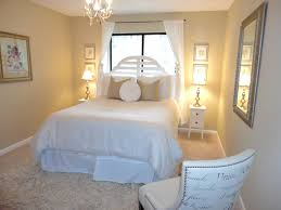 cream wall bedroom with glass window and white curtains combined