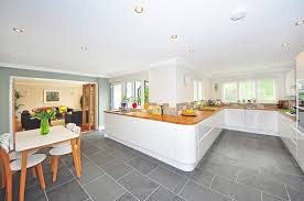 how to cut ceramic tile around kitchen cabinets best tile for kitchen floor how to make the right choice