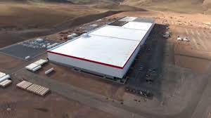 latest drone footage of tesla gigafactory shows progress