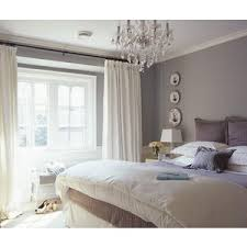 bedrooms chandelier white drapes gray walls paint