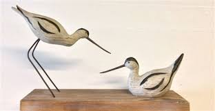 carved and painted model birds including hoopoe avocet