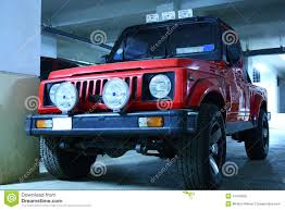 jeep maruti red color jeep with fog lights royalty free stock photos image