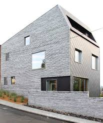 Modern Home Design For Narrow Lot Narrow Lot Uses Modern Fortress Wall For Privacy From Street