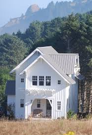 Modern Farmhouse Ranch White House Brown Roof Exterior Farmhouse With Standing Seam Metal