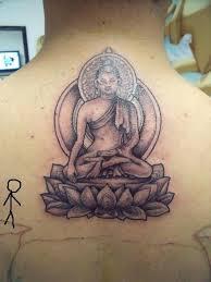 Buddhist Flower Tattoo - fantastic buddha sitting on lotus flower tattoo on upper back
