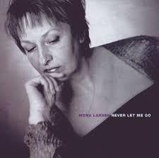 S U N D A N C E ] - Artists / Releases - Mona Larsen - NEVER LET ME GO - 209f