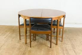 mid century teak extending dining table and 4 chairs by mcintosh