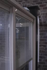 white accordion shades sliding glass door as windows treatment