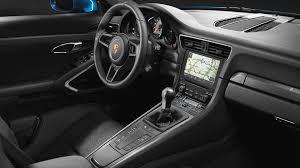 porsche 911 dark green porsche 911 gt3 touring package hides 494 hp under smooth tail