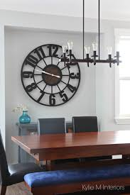 how to decorate with large clocks large clock clocks and decorating dining room with nook benjamin moore gray owl rustic industrial chandelier and large clock