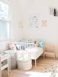 a modern pastel shared baby and toddler room happy grey lucky