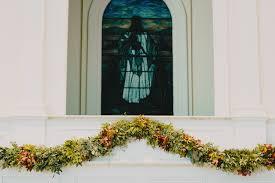 cline farm wedding with lush floral garland philosophy flowers