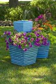 stacked garden planter with diy fountain birds and blooms