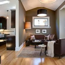 these light hardwood floors contrast dark brown furniture the