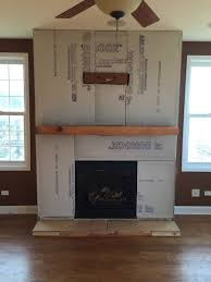 a step by step diy stone veneer installation on a fireplace in