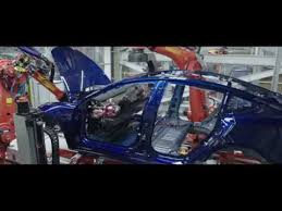 tesla model 3 first pictures from production hell youtube