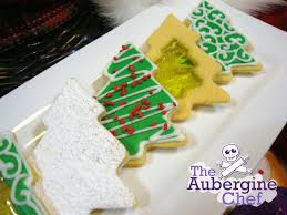 close up of royal icing christmas tree cookies 1 with logo