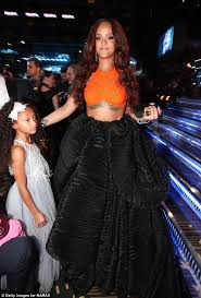 His And Her Flasks Rihanna Shows Off Her Bedazzled Flask At The Grammys Daily Mail
