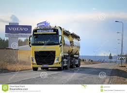 volvo heavy duty trucks yellow volvo fh tank truck on the road with volvo trucks sign