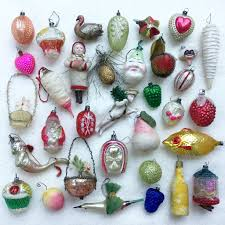 my collection of antique ornaments for my german feather tree