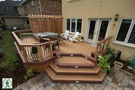 Medium Size Midheight Level Spa Deck With Pergola And Privacy - Backyard deck designs plans