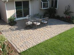 Backyard Patio Design Ideas by Paver Patio Ideas With Longue Chair Also A Black Square Table