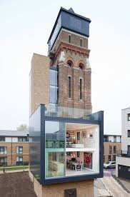 old modern old water tower transformed into a modern home