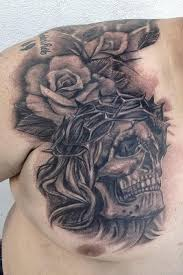 bleeding skull with crown of thorns tattoo on back in 2017 real