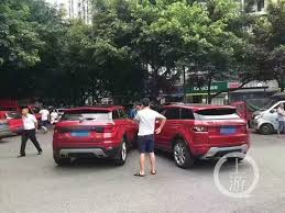 land rover red range rover evoque clone and real deal crash in china both are