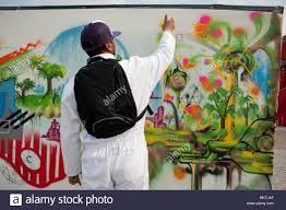 Paris Wall Murals Man Spray Painting Wall Mural Graffiti At