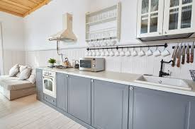 how to paint stained kitchen cabinets white everything you need to to paint your kitchen cabinets