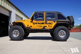 badass jeep cherokee rubicat movin on up to 40x13 50r17 cooper discoverer stt pro m t