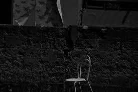 White Concrete Wall White Metal Chair Near Concrete Wall During Night Free Stock Photo