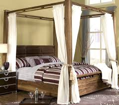 bedroom four poster bed canopy red curtains romantic and post