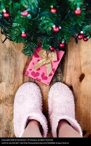 Decoration Under Christmas Tree by Child Looking Down At Present Under Christmas Tree A Royalty