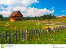 small country house meadow and wooden fence royalty free stock