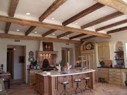 this kitchen used 7x7 live edge barn beams with 7x7 hand hewn barn