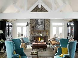 blue velvet sofa with cushions snd rectangular brown ottoman