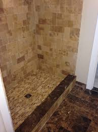 earthstone travertine shower with tuscany scabos mosaic shower