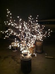 cheap wedding lighting use old milk cans branches and white