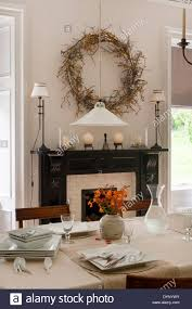 Dining Room With Fireplace by Dining Room With Wreath Over The Fireplace And Table Set Up With