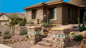 southwestern home southwestern home exterior in gravel yard brick pavers